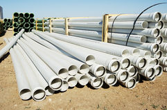 Construction Material. A bundle of sewer pipe at a residential home construction site Royalty Free Stock Image
