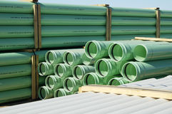 Construction Material. A bundle of sewer pipe at a residential home construction site Stock Photo