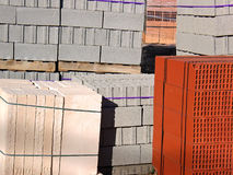 Construction Material. Stacked bricks and blocks on an store of construction material stock photos