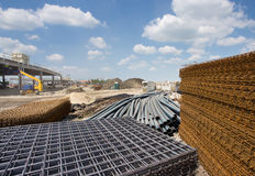 Construction material at building site. Close up of reinforcement mesh on pile and other construction material and equipment at building site royalty free stock photography