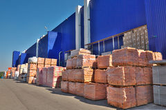 Construction materials. Stacked near the warehouse Royalty Free Stock Image