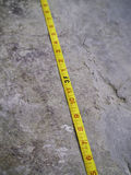 Construction Measuring Tape on grunge concrete Stock Photo