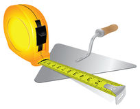 Construction measuring tape and trowel Royalty Free Stock Photo