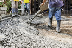 Construction Men Pouring Cement Royalty Free Stock Image