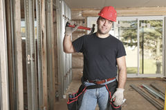 A construction  men working. A construction man working on a bilding house Stock Photo