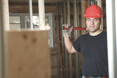 A construction  men working. A construction man working on a bilding house Stock Photography