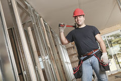 A construction  men working. A construction man working on a bilding house Stock Images