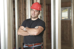 A construction men working. A construction man having arm cross Stock Photo
