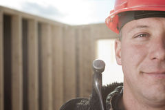 A construction men working outside. A construction man with hammer on the hand Royalty Free Stock Photos