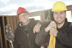 Construction men working outside. Two construction men working outside Royalty Free Stock Image