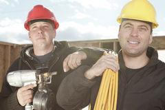 Construction men working outside. Two construction men working outside Stock Image