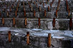 Construction of metal pipes in concrete. Preparation for the fountain. royalty free stock photography
