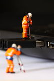Construction model workers USB cable F Royalty Free Stock Image