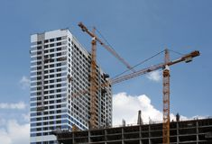 Construction of modern buildin. A building under construction and a crane Stock Photo