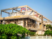 Construction of modern building made of concrete and white foam blocks. Many scaffolding. Construction at summertime. Construction of modern building made of royalty free stock images