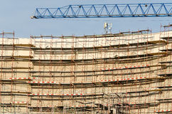 Construction Of A Modern Building With Scaffolds And Crane Royalty Free Stock Photo