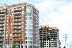 Construction and modern condo buildings with huge windows and balconies in Montreal. Canada Royalty Free Stock Images