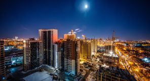 Construction of modern high multistory residential buildings, night aerial view of building yard royalty free stock photos