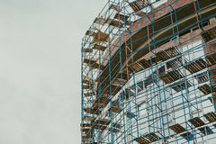 Construction of a modern house. Glass facade in scaffolding Stock Image