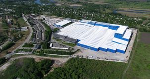 The construction of a modern production building or factory, the exterior of a large modern production plant or factory stock video