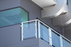 Construction modern style aluminum rail and fall protection tem. Pered glass stock images
