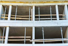 Construction of a monolithic house made of concrete, concrete support, formwork and racks stock photography