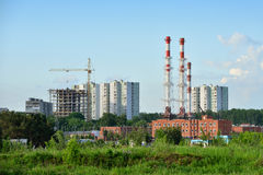 Construction of multi-level residential buildings next to an ind Stock Photo