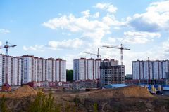 Construction of a new multi-storey building on the river Bank stock photography