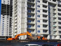 Construction of a multi-storey building. Mobile photo stock image