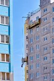 Construction of a multi-storey building in a young neighborhood royalty free stock images