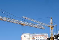 Construction of a multi-storey buildings. Construction cranes in sky background. Construction of a multi-storey buildings. Construction cranes in sky background Royalty Free Stock Image