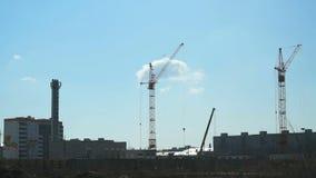 Construction of multi-storey buildings.Cranes work stock footage