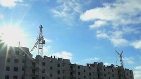 Construction of multi-storey buildings.Cranes work. Construction of multi-storey buildings. Construction cranes work. Timelapse stock video