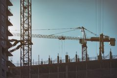 Construction of multi-storey panel houses, Skyscraper in the metropolis with high cranes. Building Moscow.  Stock Photo