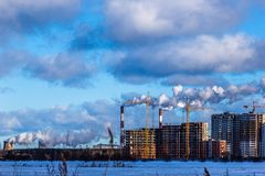 Construction of multi-storey residential buildings in the big city. Winter city landscape stock photos