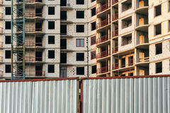 Construction of multistory building behind the closed gates Royalty Free Stock Image