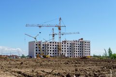 Construction of a multistory building. Cranes work Royalty Free Stock Images