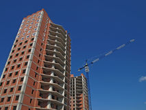 The construction of a multistory building, skyscraper. Construction of multi-storey high-rise apartment houses, the building housing for people, construction Royalty Free Stock Photography