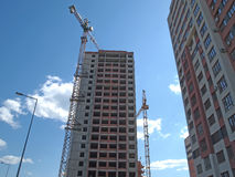 The construction of a multistory building, skyscraper. Construction of multi-storey high-rise apartment houses, the building housing for people, construction Royalty Free Stock Image