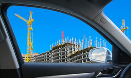 Construction of multystoried buildings from car window Royalty Free Stock Image