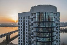 Construction of new apartment buildings at sunset. Construction of new apartment buildings in Kiev. view of the river Dnieper and the bridge evening at sunset stock photos
