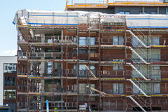 Construction of new apartments with completed apartments in the Stock Photo
