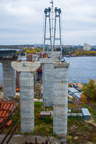 Construction of the new arch bridge. Across the Dnieper River on an overcast day Stock Photography