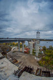Construction of the new arch bridge. Across the Dnieper River on an overcast day Stock Images