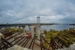 Construction of the new arch bridge. Across the Dnieper River on an overcast day Stock Photo