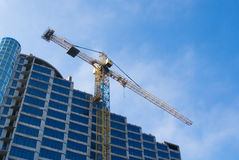 Construction - new blue glass building and crane Stock Image
