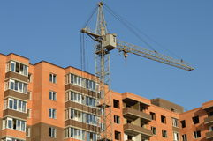 Construction of the new brick building by means of the elevating Stock Images