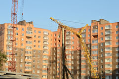 Construction of the new brick building by means of the elevating Stock Photography
