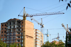 Construction of the new brick building by means of the elevating Royalty Free Stock Photos