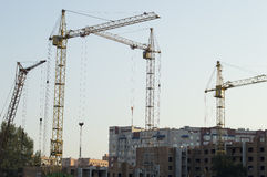 Construction of the new brick building by means of the elevating Stock Image